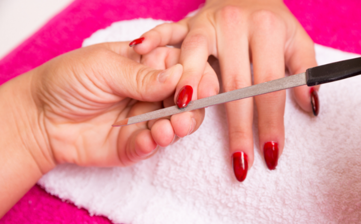 With a coarse nail file, loosen up the top layer.